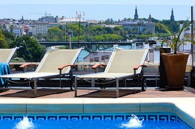 Sunbathe and refresh in our outdoor pool solarium