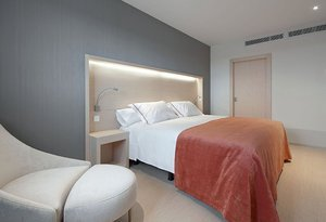Spacious and well-lit 24-square-metre room with a King size bed ...