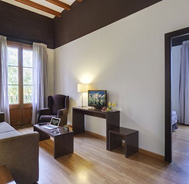 We offer spacious rooms with living area