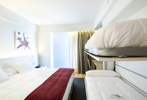 Our hotel has 25-square-metre family rooms. They are decorated with ...
