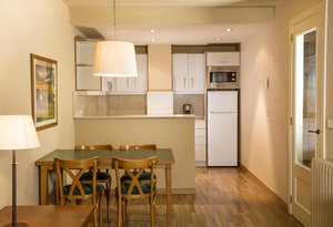 Apartments equipped with living-room with equipped kitchen, satellite TV, and ...