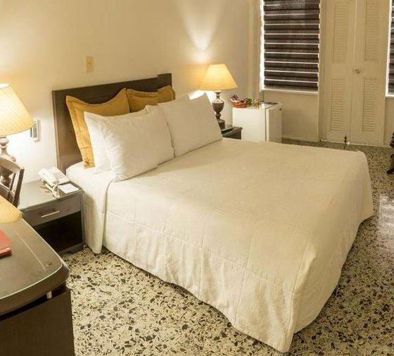 Settle into the standard rooms of the Sercotel Tequendama Inn ...