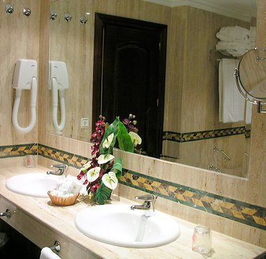 Private bathrooms with hairdryer and amenities
