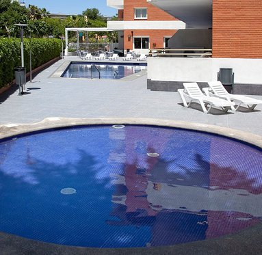 Relax in our outdoor swimming pool