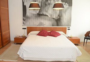 Sercotel Aparthotel Suites Huesca  offers 2 deluxe rooms that have ...