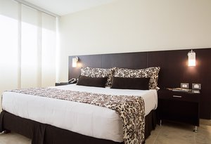 Stay in the simply-furnished standard rooms at Sercotel Casino International ...
