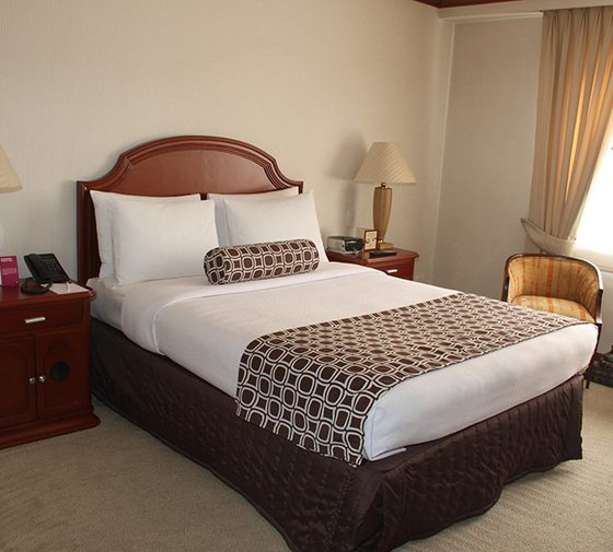The single and twin deluxe rooms feature double beds or ...