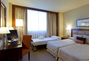 Sercotel Nuevo Madrid Hotel bids you spacious executive rooms for ...