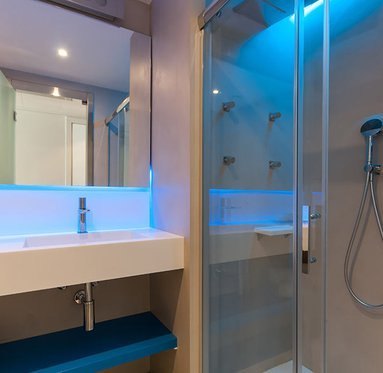 The bathrooms have showers with thermostatic leds
