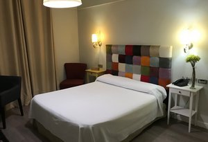 The hotel features double rooms with queen beds or individual ...