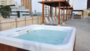 Relax in the jacuzzi located at the terrace of the ...
