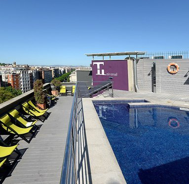 Cool off in the rooftop pool of our hotel