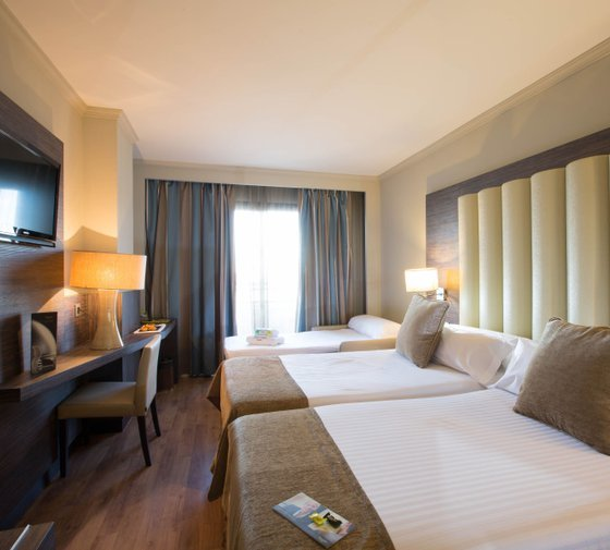 Our hotel offers you triple rooms with 2 double beds ...