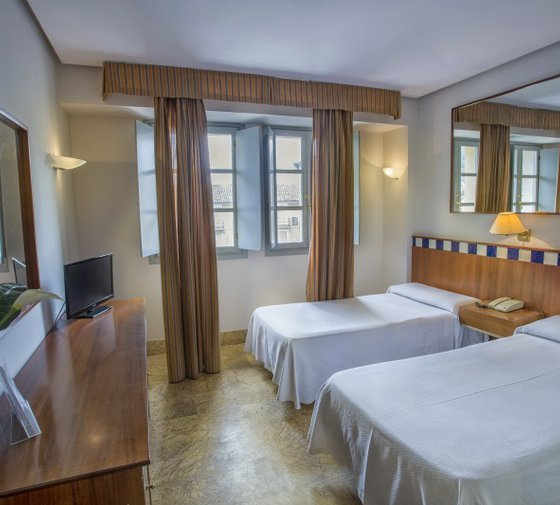 The double rooms with extra bed of the Sercotel Ciudad ...