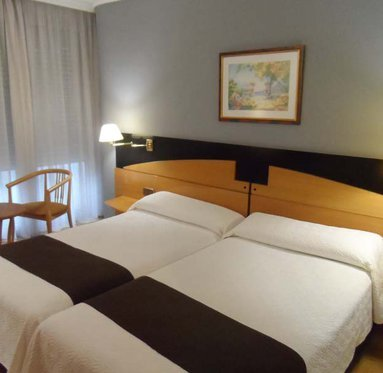 Stay in the spacious rooms at the Corona de Castilla ...