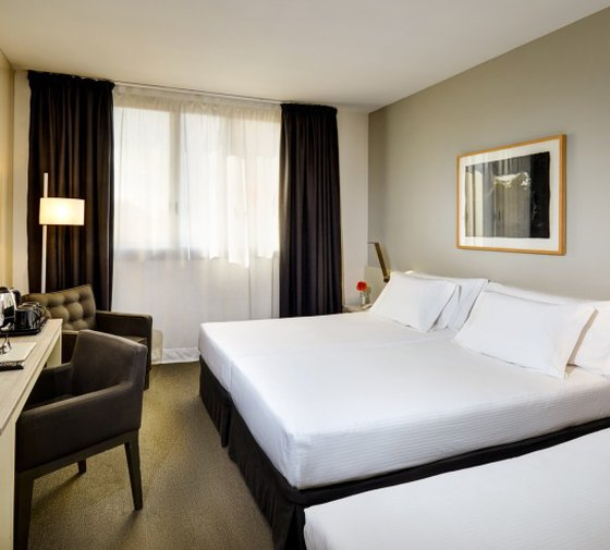 Sercotel Ámister Art Hotel has rooms that can accommodate three ...