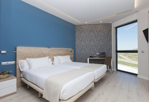 Our Deluxe Rooms are located on the upper floors of ...