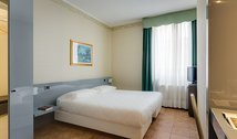 In Milan, fully equipped rooms.